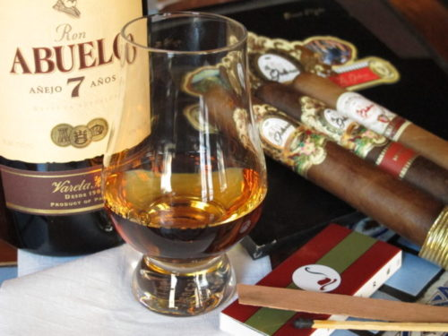 image of 2 cigars and glass of rum